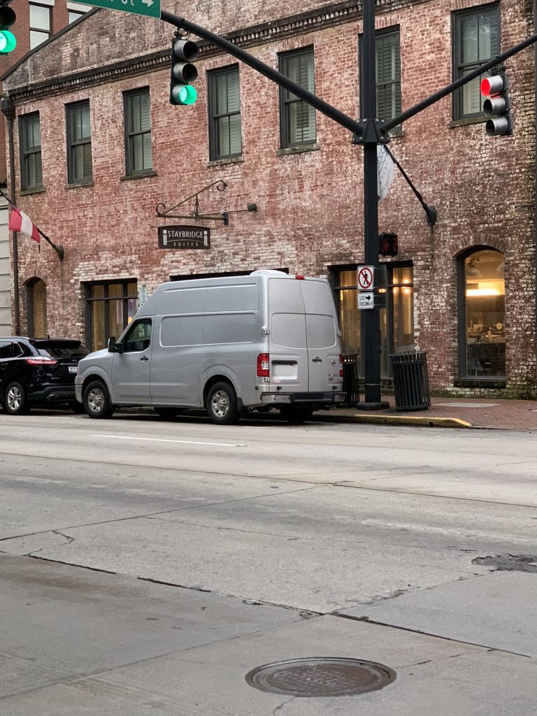 vanlifers parked on a city street