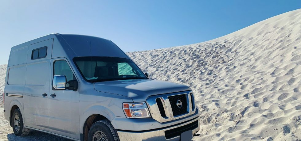 van on the beach in free campsites
