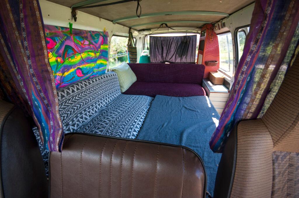 Interior view of simple, DIY camper van conversion