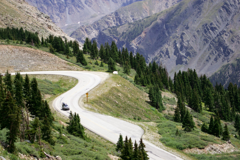van driving on curvy road in Colorado mountains