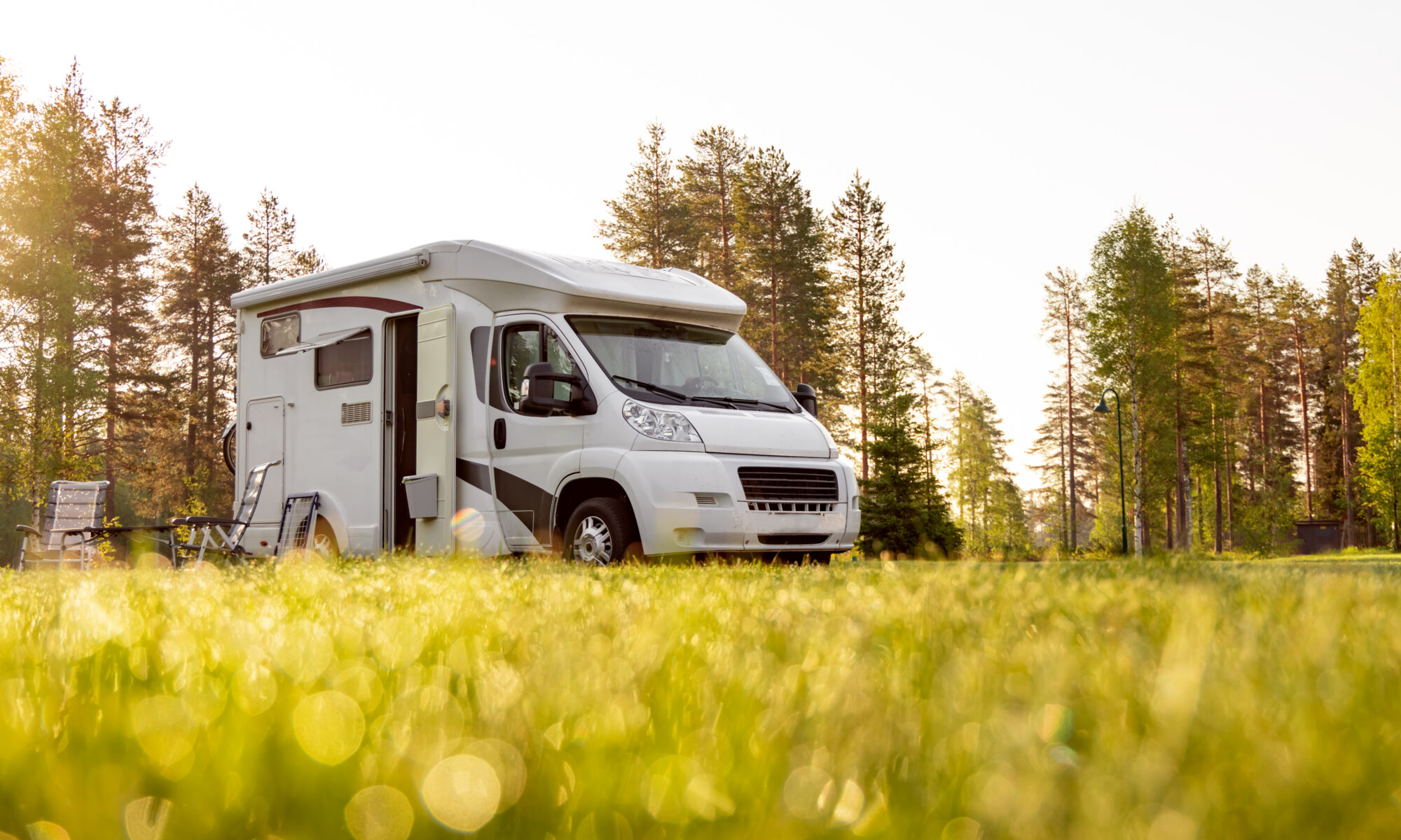 A class B camper van in a meadow